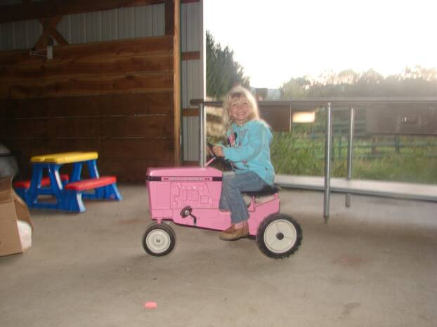 Abby on Her Pink-Pedal Tractor