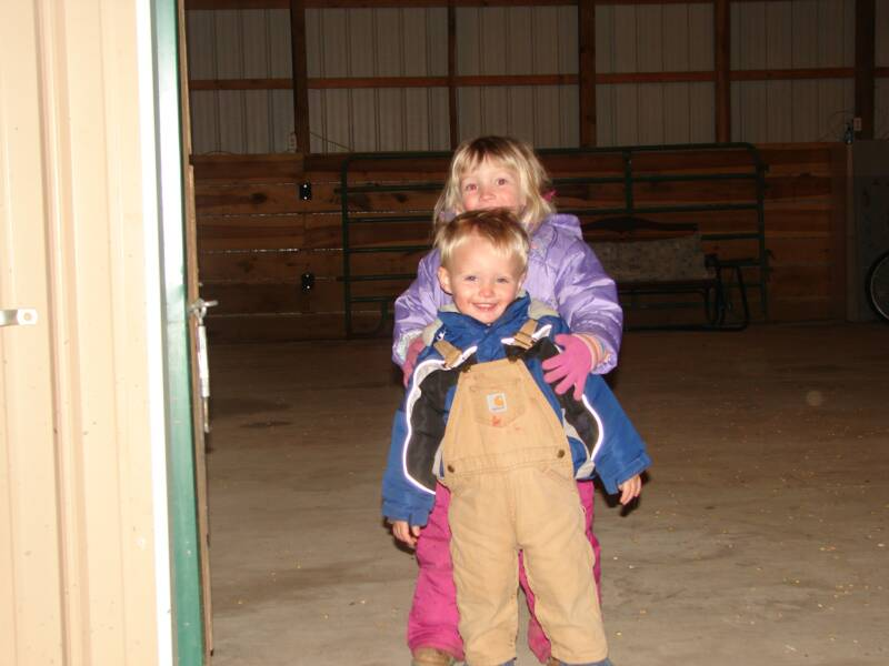Abby and Austin playing in the barn during one of the birthday parties