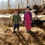 Abby and Austin in barn with easter lambs winter of 2011
